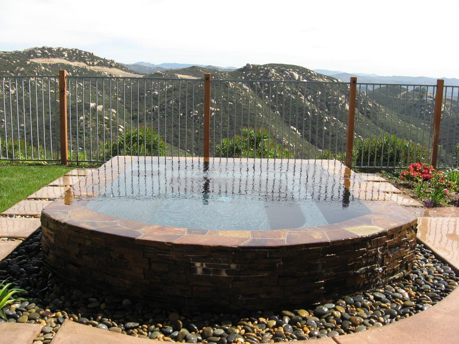 Spa with negative edge water feature